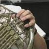 Comment atteindre des notes faibles sur un cor français