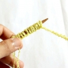 Comment tricoter une étui pour ipod avec une sangle de transport