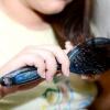 Comment faire un chignon de cheveux qui feront de votre cheveux bouclés