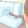 Comment enfiler une machine à coudre singer