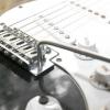 Comment utiliser une barre de vibrato de la guitare